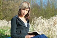 Woman Reading on Grass Royalty Free Stock Image