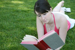 Woman reading on grass Royalty Free Stock Photo