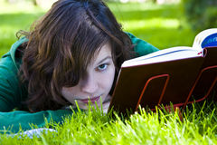 Woman reading on grass Royalty Free Stock Photography