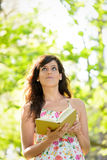 Woman reading and having idea Royalty Free Stock Photography