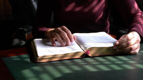 Woman reading her bible, closeup view.