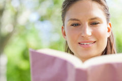 Woman reading her book in the park Stock Photography