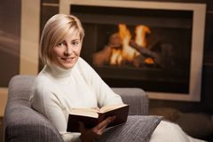 Woman reading at home Stock Photography