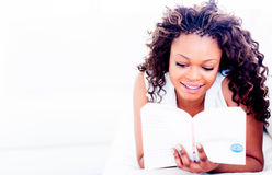 Woman reading at home Stock Images