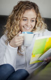 Woman reading at home with a coffee Stock Photos