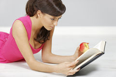 Woman reading at home Royalty Free Stock Photo