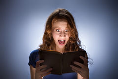 Woman reading horror book nad Royalty Free Stock Photo