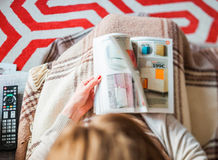 Woman reading IKEA catalog furnishing house Royalty Free Stock Photos