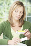 Woman Reading Information On Drug Packaging Royalty Free Stock Photos