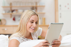 Woman reading information on her tablet Stock Images