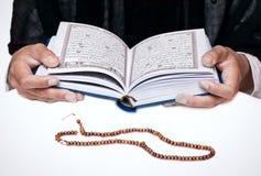 Woman reading Koran Stock Image