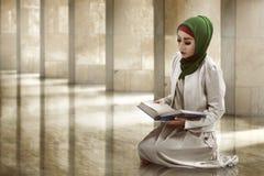 Woman Reading Koran Stock Photos