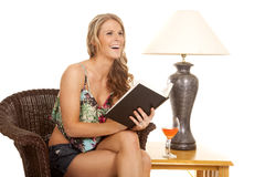 Woman reading by lamp laugh Royalty Free Stock Image