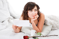 Woman reading letter Royalty Free Stock Image