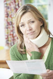 Woman Reading Letter After Receiving Neck Injury Royalty Free Stock Photo