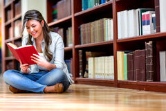 Woman reading at the library Royalty Free Stock Image
