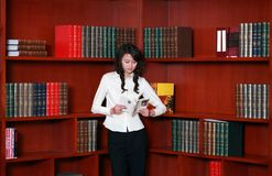 Woman reading in library. Asian  young woman reading in library Stock Photos