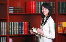 Woman reading in library. Asian  young woman reading in library Stock Photo