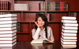 Woman reading in library. Asian  young woman reading in library Stock Image