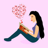 Woman reading love book Stock Photography