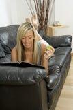 Woman reading magazine Royalty Free Stock Photography