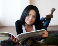 Woman is reading the magazine Royalty Free Stock Images