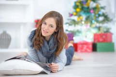 Woman reading magazine on floor Royalty Free Stock Photo