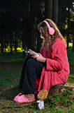 Woman is reading magazine at forest Stock Photo