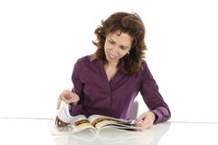 Woman reading in a magazine Royalty Free Stock Photo