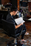 Woman reading a magazine Royalty Free Stock Image