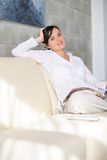 Woman reading magazine at home Royalty Free Stock Image