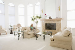Woman reading magazine in living room Royalty Free Stock Images
