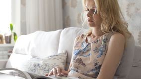 Woman reading. Magazine in the room Stock Image