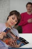 Woman reading magazine Royalty Free Stock Photos