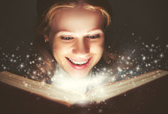 Woman reading a magic book royalty free stock photo