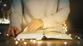 Woman is reading a magical book. christmas concept