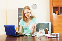 Woman reading manual of medications in internet Royalty Free Stock Photography
