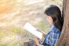Woman reading a map Royalty Free Stock Image