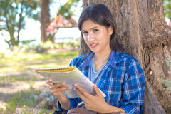 Woman reading a map Stock Image