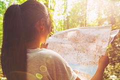 Woman in reading a map in the forest Royalty Free Stock Image