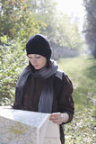 Woman Reading Map Outdoors Royalty Free Stock Photography
