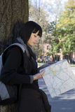 Woman Reading Map Outdoors Stock Image