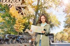 Woman reading map riding through Paris Royalty Free Stock Images