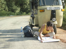 Woman Reading Map On Road By Autorickshaw Stock Images