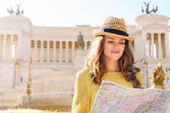 Woman reading map at Venice Square in Rome in summer Stock Photos