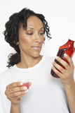 Woman Reading Medicine Bottle Royalty Free Stock Photography