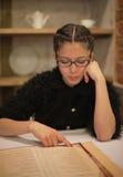 Woman reading menu Stock Photo