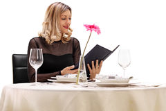 Woman reading the menu Royalty Free Stock Photos