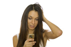 Woman reading message on mobile phone Royalty Free Stock Photos