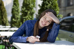 Woman reading a message on the phone Stock Image